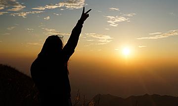 silhouette of a girl watching the sunset in wugong mountain jiangxi