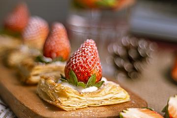 freshly baked small strawberry tart close up