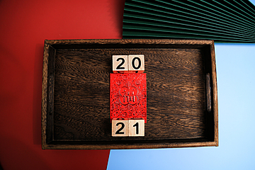 2021 digital cards and new year red envelopes on wooden pallets