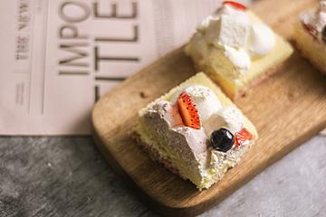 strawberry cream cake closeup on wooden tray