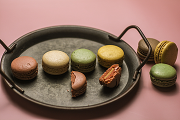 french dessert macarons in an iron basin