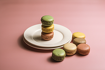 macarons stacked on white plates