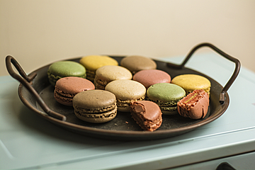 small round cake macarons in an iron basin