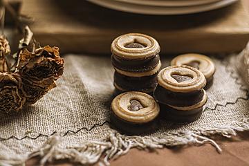 stacked chocolate sauce sandwich cookies closeup