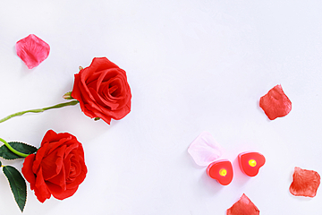 red rose flower and heart candle