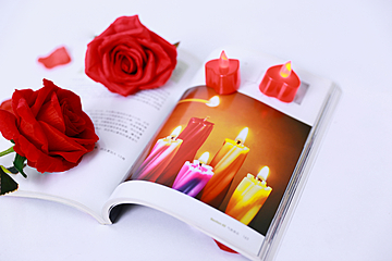 romantic colorful candles and roses valentines day background