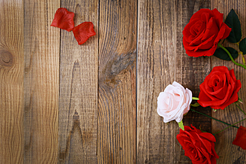 valentines day roses placed on wooden board