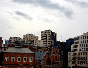 tall buildings under dark clouds