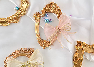 four photo frames with pearl bow on white background