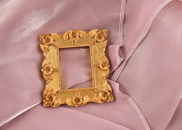 square photo frame on pink background