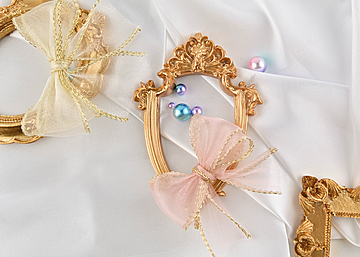 three photo frames with bow pearls on white background