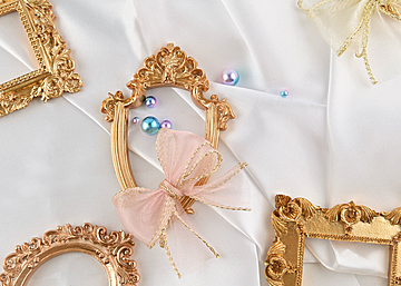 three photo frames with pearl bow on white background