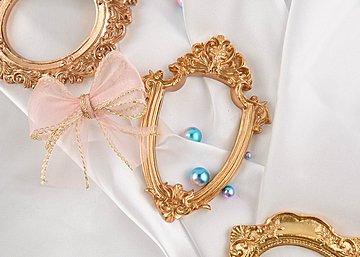 three photo frames with pearls and bows on white background