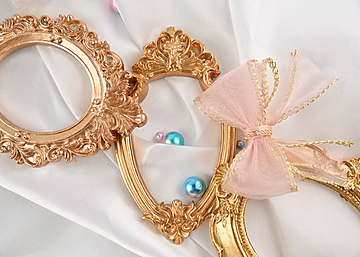 three photo frames with pearls and bows on white
