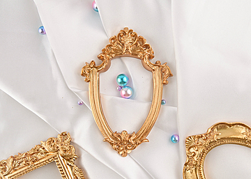 three photo frames with pearls on white background