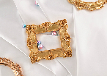 three photo frames with pearls on white