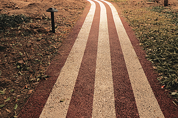 red and white road in the sunset