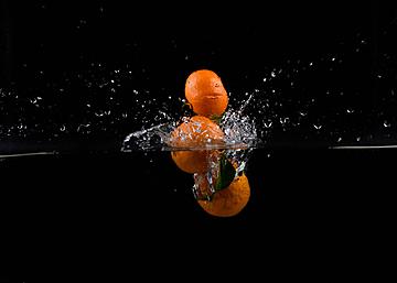 three orange bubble splash