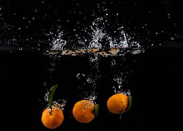 three orange splash bubbles
