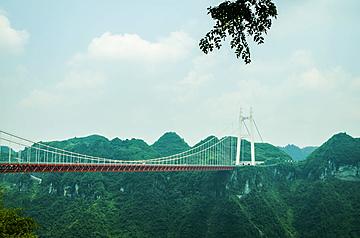 the distant view of aizhai bridge in hunan