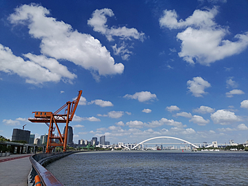 xuhui riverside under the blue sky and white clouds